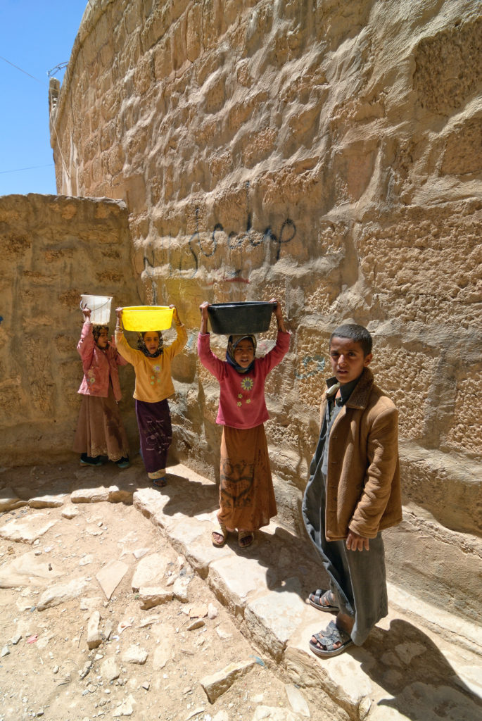 children carry water in Yemen
